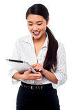 Corporate woman brwosing on tablet pc Stock Photos