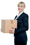 Corporate woman with a cardboard box in hand. Shifting her office Royalty Free Stock Photography