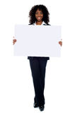 Corporate woman displaying white ad board Royalty Free Stock Images
