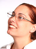 Corporate Woman with Eye Glasses. Corporate woman smiling with eye glasses royalty free stock images