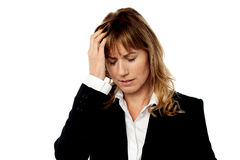 Corporate woman having headache Stock Photos
