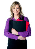 Corporate woman holding documents tightly Royalty Free Stock Photos