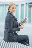 Corporate Woman Holding Tablet Outside Office Stock Images