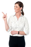 Corporate woman pointing away at something Royalty Free Stock Images