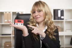 Corporate Woman Pointing Model House on Palm Stock Photo
