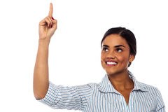 Corporate woman pointing upwards Stock Photo