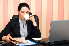 Corporate woman reading news Stock Photography