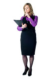 Corporate woman reading official documents Royalty Free Stock Photo