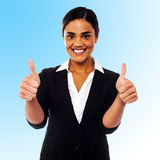 Corporate woman showing double thumbs up Stock Photography