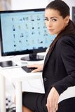 Corporate Woman Sitting at Worktable with Computer Royalty Free Stock Photo