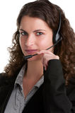 Help Line. Corporate woman talking over her headset, isolated in a white background Royalty Free Stock Photo