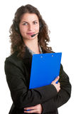 Help Line. Corporate woman talking over her headset, isolated in a white background Stock Photography