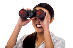 Corporate woman viewing through binoculars Stock Photography