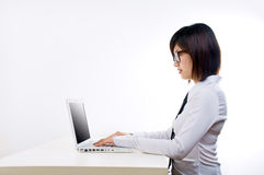 Corporate woman working on laptop Royalty Free Stock Photos