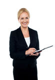 Corporate woman writing on clipboard Royalty Free Stock Image