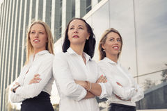 Corporate women standing with crossed hands Royalty Free Stock Photography