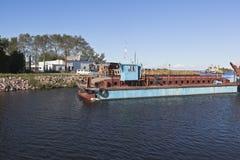 Corporate work boat Swan passes through the bridge divorced Ilinskiy in the city of Belozersk, Vologda region Stock Images