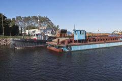 Corporate work boat Swan passes through the bridge divorced Ilinskiy in the city of Belozersk Royalty Free Stock Photo