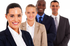 Corporate worker. Pretty female corporate worker and team on white Royalty Free Stock Image