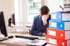 Corporate worker depressed from the workload Royalty Free Stock Photo