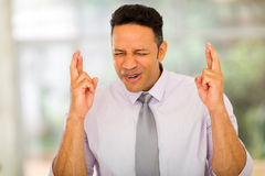 Corporate worker finger crossed Stock Image