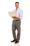 Corporate worker holding laptop Stock Photos