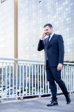 Corporate worker talking on phone Royalty Free Stock Photos