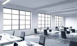 Corporate Workplaces Equipped By Modern Laptops In A Modern Panoramic Office With White Windows. Black Leather Chairs And White Ta
