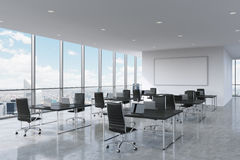 Corporate workplaces equipped by modern laptops in a modern panoramic office in New York City.. Black leather chairs and a black tables, a huge whiteboard on Stock Images