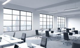 Corporate workplaces equipped by modern laptops in a modern panoramic office  Stock Photos