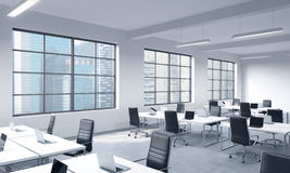 Corporate workplaces equipped by modern laptops in a modern panoramic office  Royalty Free Stock Images