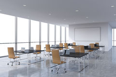 Corporate workplaces equipped by modern laptops in a modern panoramic office, white copy space in the windows. Brown leather chair Royalty Free Stock Photography