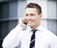 Corporate Young Man On Cellular Phone. And Smiling Stock Photos
