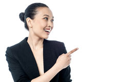 Corporate young woman pointing away Stock Image