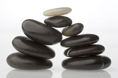 Corporate  zen. Rocks stacked one one top of another is an art form. A type of Zen if you will. Corporate America can surely use more of this. Space on left for Stock Image