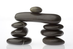 Corporate  zen. Rocks stacked one one top of another is an art form. A type of Zen if you will. Corporate America can surely use more of this. Space on left for Stock Photo