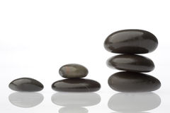 Corporate  zen. Rocks stacked one one top of another is an art form. A type of Zen if you will. Corporate America can surely use more of this. Space on left for Royalty Free Stock Images