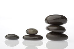 Corporate  zen. Rocks stacked one one top of another is an art form. A type of Zen if you will. Corporate America can surely use more of this. Space on left for Stock Photos