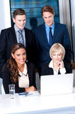 Corporates with businesswomen on foreground Stock Photography