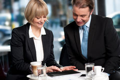 Corporates discussing business over a coffee Royalty Free Stock Photo