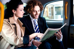 Corporates discussing finances published in newspaper Stock Photo