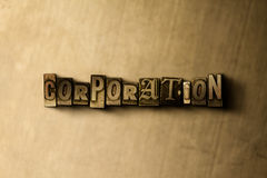 CORPORATION - close-up of grungy vintage typeset word on metal backdrop Royalty Free Stock Photo