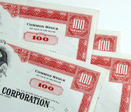 Corporation common stock shares. Red common stock certificates of an American corporation. Beautiful old documents of wealth Royalty Free Stock Images
