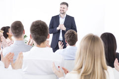 Corporation management meeting. Management leader making a speech about company's strategy during business meeting in a corporation royalty free stock image