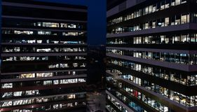 Corporation office buildings at night. Late working Royalty Free Stock Image