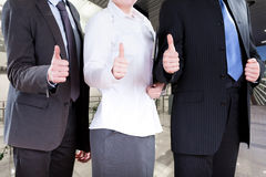 Corporation workers. Standing with their thumbs up Stock Images