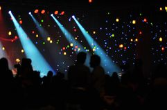 Corporative for employees. Concert in a dark hall with lighting stock photo