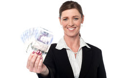 Corprorate woman holding currency notes Stock Image
