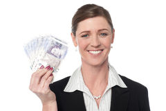Corprorate woman holding currency notes Stock Images