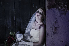 Corpse Bride with grunge wall. Halloween theme: Horror scene of corpse bride with copy space royalty free stock photos